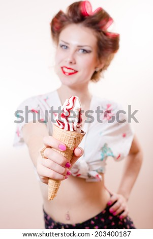 sexy funny pinup girl eating ice cream cone looking at camera happy smile isolated on white copy space background portrait image - stock photo