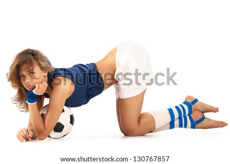 Sexy girl doing fitness with soccer ball over white background - stock photo