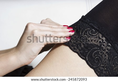 Sexy girl in black lace, part of the body - stock photo