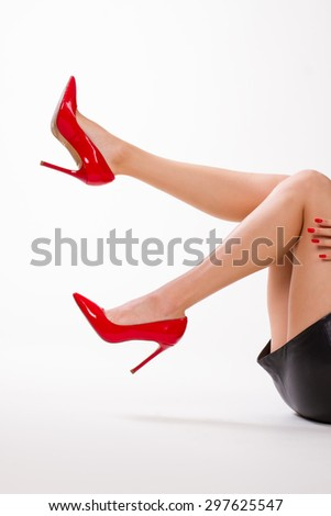 Sexy girl in red shoes. Girl moves her beautiful legs. - stock photo