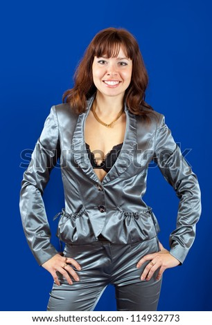 sexy girl in silver suit over blue background - stock photo