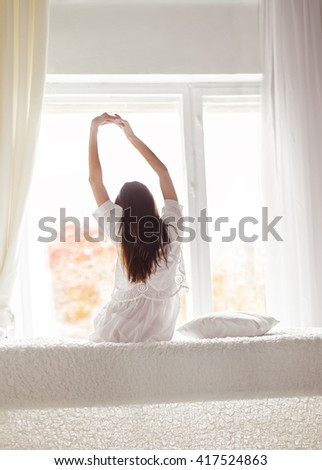 sexy girl in the morning in bed stretching - stock photo