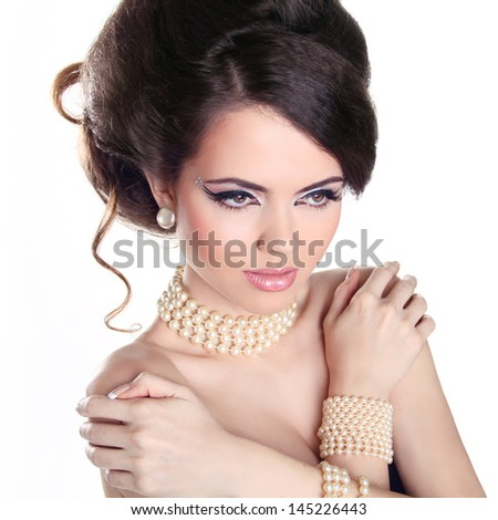Sexy Girl. Jewelry and Hairstyle. Fashion portrait of beautiful woman with pearls isolated on white background. - stock photo