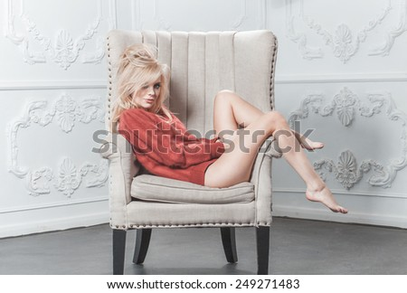 sexy girl lying in a chair - stock photo