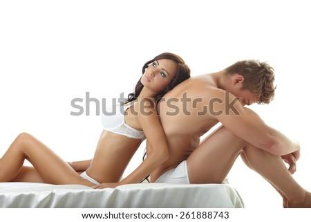 Sexy girl lying on upset guy. Concept of impotence - stock photo