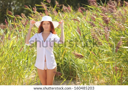 Sexy girl on a background of tall grass - stock photo