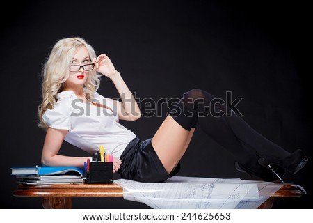 sexy girl on the desk - stock photo