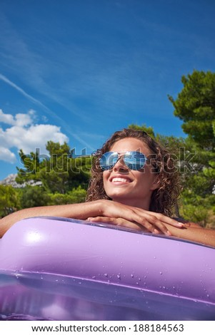 Sexy girl resting at mattress at tropical water  - stock photo