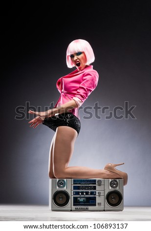 Sexy girl with a tape recorder - stock photo