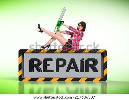 sexy girl with electric saw and repair symbol - stock photo