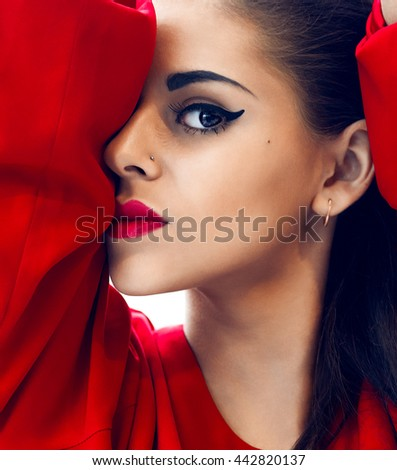 Sexy girl with red lips and black eyes closeup photo. Young female model portrait wear red blouse. Attractive Fashion lady with long brown hair wear cool outfit - stock photo