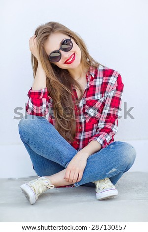sexy girl with red lips on a sunny day sunglasses - stock photo