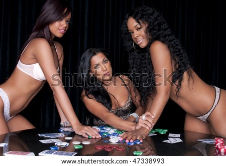 Sexy girls playing poker in lingerie at clubhouse. - stock photo