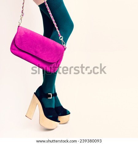 Sexy Glamorous Lady in green stockings on white background. Pink clutch. Fashion accessories. - stock photo