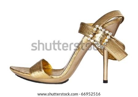Sexy golden shoe on a high heel - stock photo