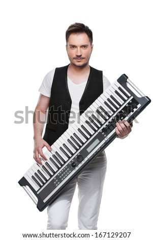 Sexy handsome man with synthesizer. Standing isolated over white background  - stock photo