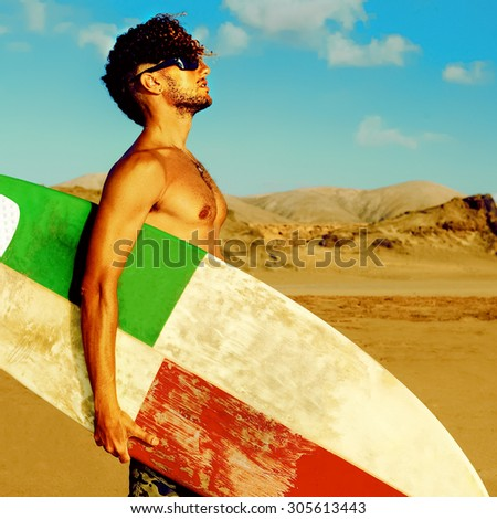 Sexy handsome Surfer on the Beach with a board - stock photo