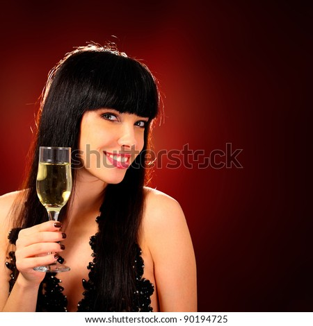 Sexy happy woman with champagne glass over red background - stock photo