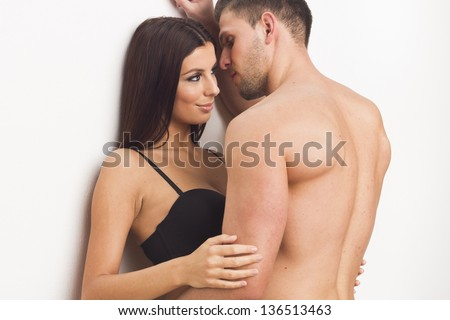 Sexy heterosexual passion couple on white isolated background - stock photo