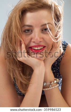 Sexy hot woman with glasses in a flower dress. High caucasian attractive cheerful happy sexy female model brunette hair shakes her head in the studio - stock photo
