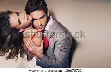 Sexy hugging couple - stock photo