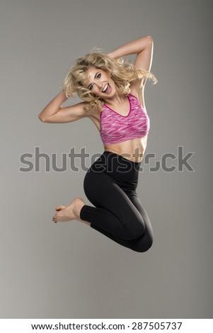 Sexy jumping blonde woman - stock photo