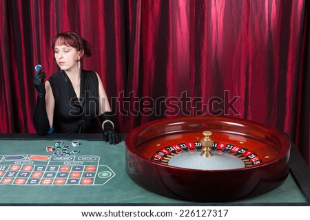 Sexy lass playing in casino - stock photo