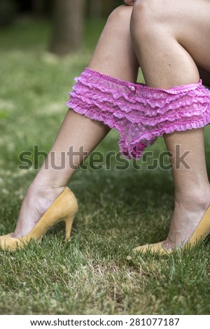sexy legs and pink panties pulling down on heels - stock photo