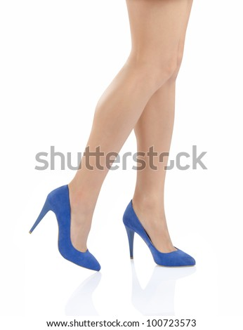 Sexy legs in blue high heels isolated on white background. - stock photo