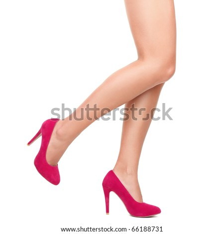 Sexy legs in pink high heels isolated on white background. - stock photo