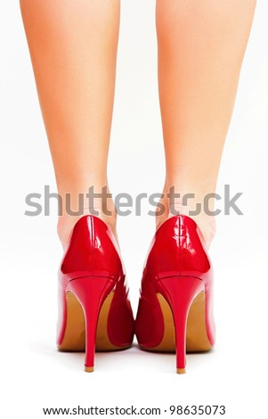 Sexy legs in red high heels isolated on white background - stock photo