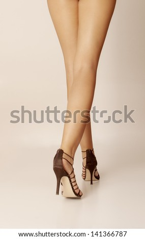 Sexy legs of a woman in high heels - stock photo