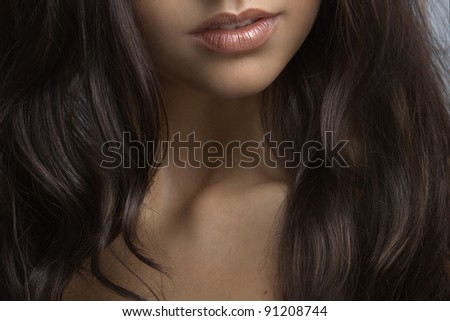 sexy lips a beautiful brunette with long hair close up - stock photo