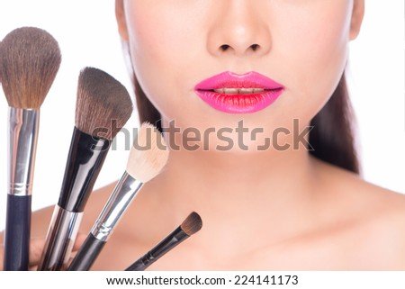 Sexy Lips. Beauty Pink Red Lips Makeup Detail. Beautiful Make-up Closeup. Sensual Open Mouth. lipstick or Lipgloss. Two tone lips. Beauty Girl with Makeup Brushes. Perfect Skin. Applying Makeup - stock photo