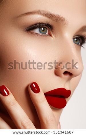 Sexy lips. Beauty red lips makeup detail. Beautiful make-up closeup. Beautiful fashion model girl face. Perfect skin. Make up. Red manicure - stock photo