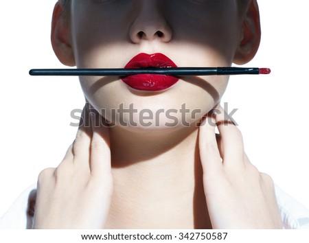 Sexy Lips. Beauty Red Lips Makeup Detail. Beautiful Make-up Closeup. Sensual Open Mouth. Lipstick or Lipgloss on white background - stock photo
