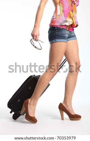 Sexy long legs going on holiday with suitcase - stock photo
