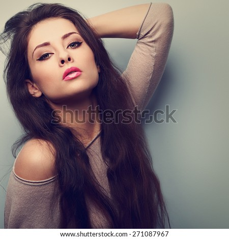 Sexy makeup female model posing with long hair and pink lips. Vintage closeup portrait - stock photo