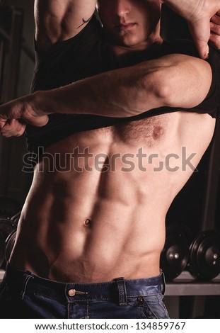 Sexy male fitness model. Fashion portrait - stock photo