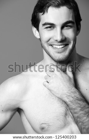 sexy male fitness model in brief shorts. Black-and-white photo. - stock photo
