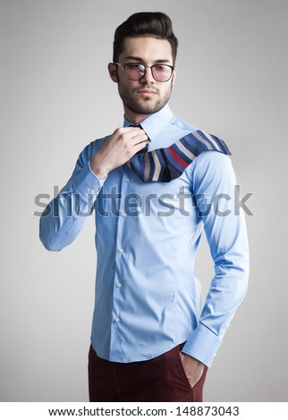 sexy man dressed elegant with s sock tie looking serious - funny concept - stock photo