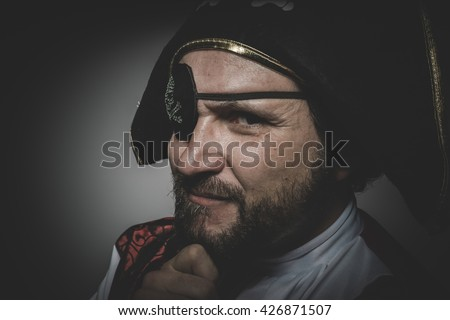 Sexy man pirate with eye patch and old hat with funny faces and expressive - stock photo