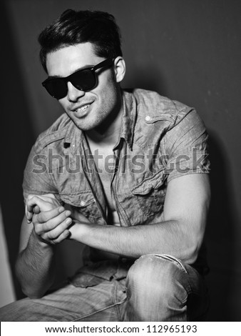 Sexy man smiling - vintage stylized black and white photo (Photo has an intentional film grain) - stock photo