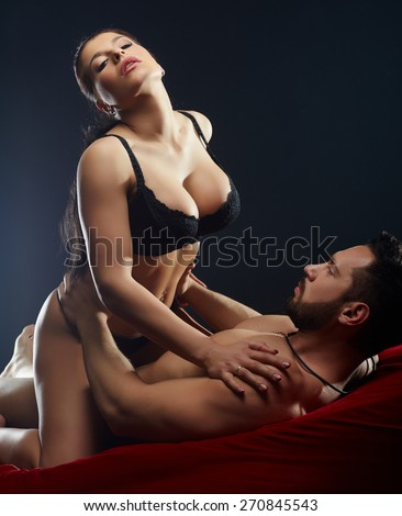 Sexy man staring at bust of his mistress - stock photo