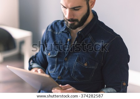 Sexy man using tablet - stock photo