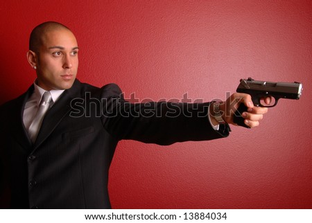 Sexy man with gun. - stock photo