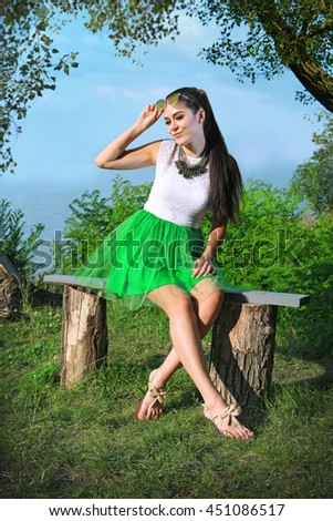 Sexy model in a green skirt and glasses - stock photo