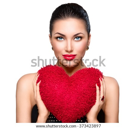 Sexy model Woman portrait. Gorgeous young brunette woman with heart shaped red pillow. Perfect make up. Valentine' Day brunette lady headshot. Valentine, love - stock photo