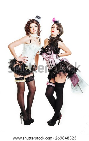 Sexy moulin rouge lesbian girls wearing hot lingerie. Girls in style Moulin Rouge fashion. Glamorous sexy women in Moulin Rouge style hat and sequins fashion cabaret party. sex minorities prostitutes - stock photo