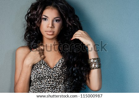 Sexy mulatto girl with long hair - stock photo